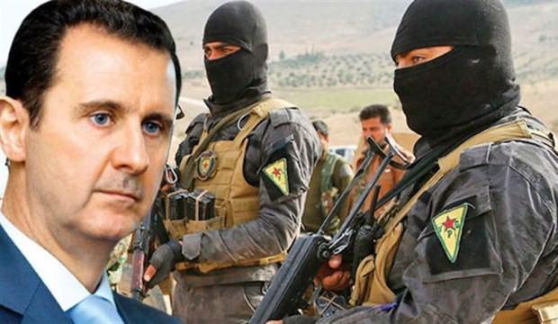 YPG'liler Esed rejimi üniforması giyiyor