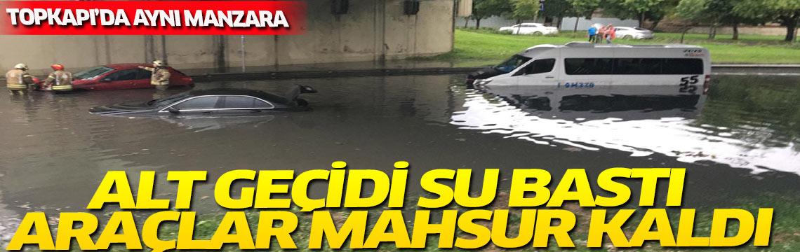 İstanbul'da yağmur ve dolu hayatı felç etti. Araçlar alt geçitte suya gömüldü.